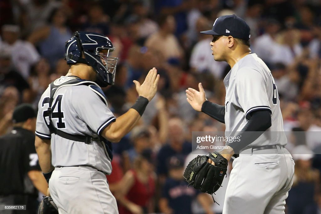 Dellin Betances #68 high fives Gary Sanchez #24 of the New York Yankees after the victory over the Boston Red Sox at Fenway Park on August 19, 2017 in Boston, Massachusetts.