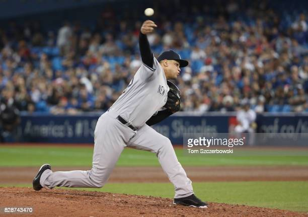 Dellin Betances of the New York Yankees delivers a pitch in the eighth inning during MLB game action against the Toronto Blue Jays at Rogers Centre...