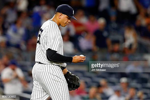 Dellin Betances of the New York Yankees looks at the ball after surrendering a run in the ninth inning against the Los Angeles Dodgers at Yankee...