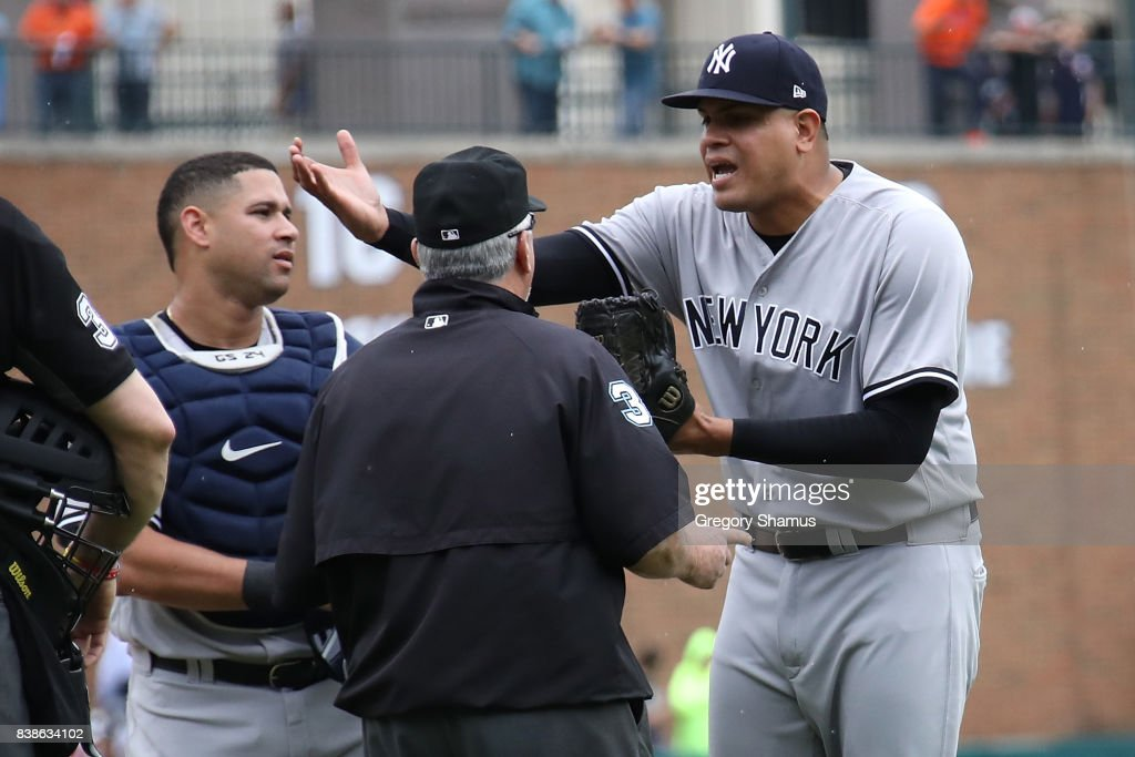 Dellin Betances #68 of the New York Yankees reacts to being ejected from the game by umpire Dana DeMuth after hitting James McCann #34 of the Detroit Tigers in the head with a pitch in the seventh inning at Comerica Park on August 24, 2017 in Detroit, Michigan.