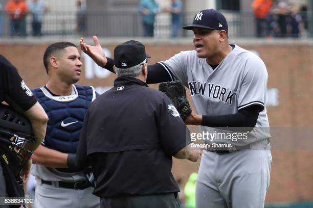 Dellin Betances of the New York Yankees reacts to being ejected from the game by umpire Dana DeMuth after hitting James McCann of the Detroit Tigers...