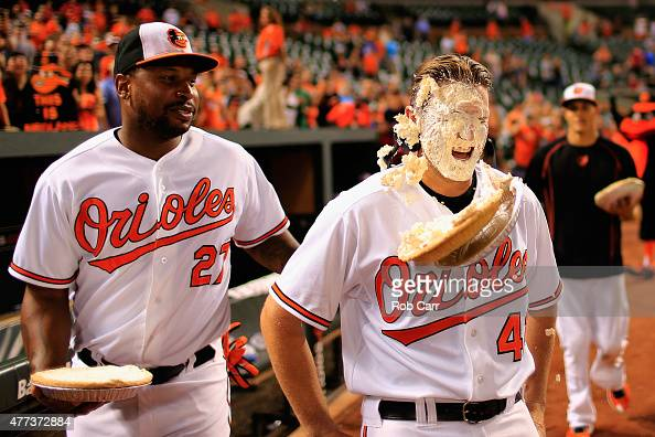 Delmon Young looks on as Chris Parmelee of the Baltimore Orioles gets hit with a pie following the Orioles 193 win over the Philadelphia Phillies...