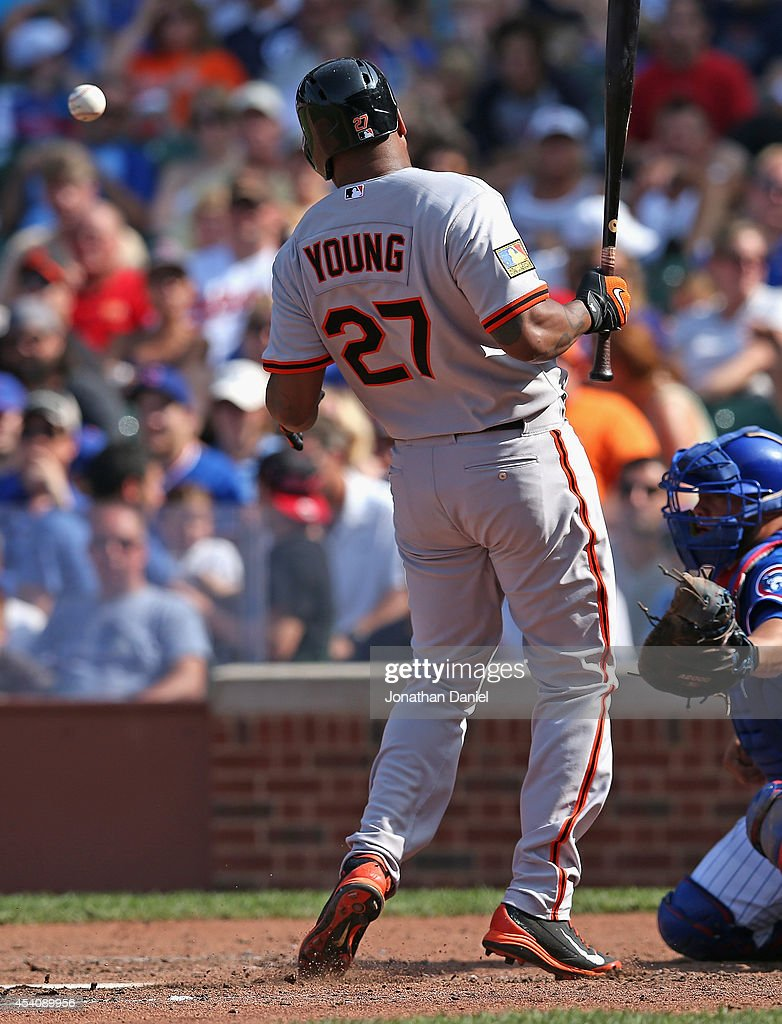 <a gi-track='captionPersonalityLinkClicked' href=/galleries/search?phrase=Delmon+Young&family=editorial&specificpeople=700362 ng-click='$event.stopPropagation()'>Delmon Young</a> #27 of the Baltimore Orioles is hit by a pitch in the 7th inning against the Chicago Cubs at Wrigley Field on August 24, 2014 in Chicago, Illinois. The Cubs defeated the Orioles 2-1.