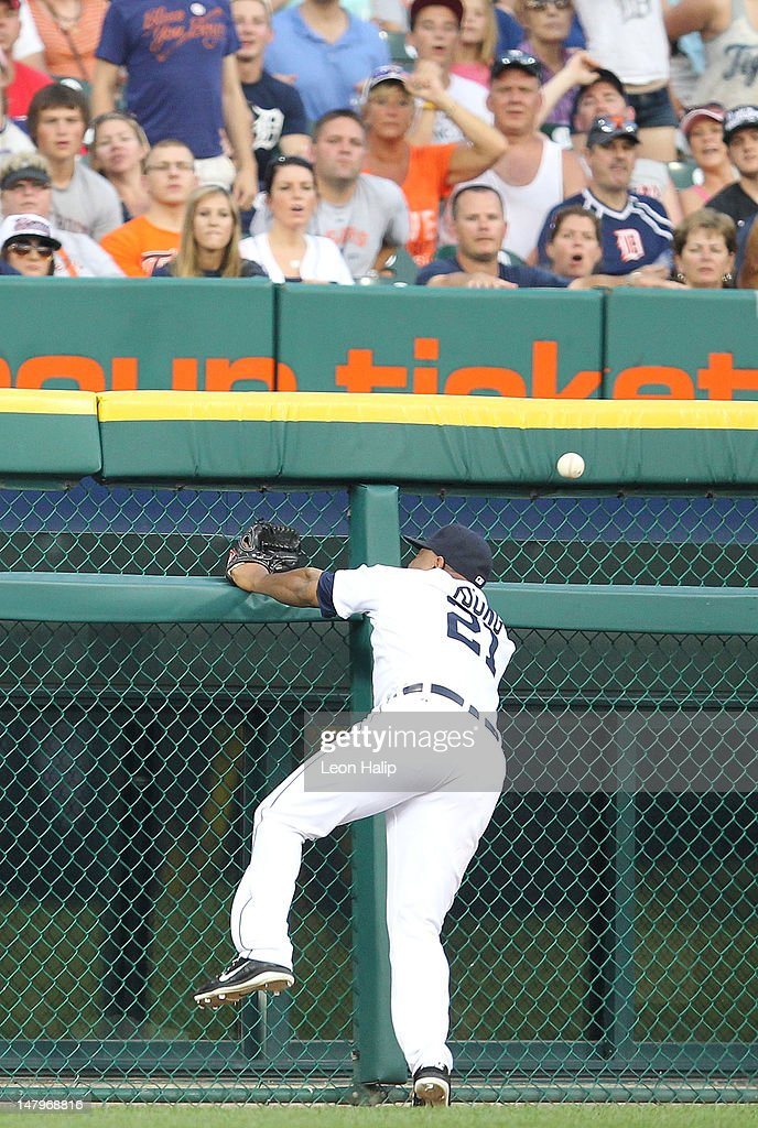 <a gi-track='captionPersonalityLinkClicked' href=/galleries/search?phrase=Delmon+Young&family=editorial&specificpeople=700362 ng-click='$event.stopPropagation()'>Delmon Young</a> #21 of the Detroit Tigers attempts to make the catch off the ball hit by Yuniesky Betancourt #11 of the Kansas City Royals in the sixth inning of the game at Comerica Park on July 6, 2012 in Detroit, Michigan. The Tigers defeated the Royals 4-2.