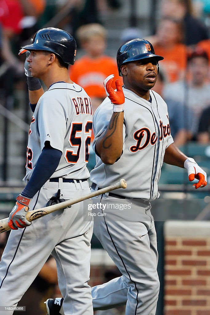 <a gi-track='captionPersonalityLinkClicked' href=/galleries/search?phrase=Delmon+Young&family=editorial&specificpeople=700362 ng-click='$event.stopPropagation()'>Delmon Young</a> #21 of the Detroit Tigers celebrates scoring with teammate Quintin Berry #52 during the eleventh inning against the Baltimore Orioles at Oriole Park at Camden Yards on July 14, 2012 in Baltimore, Maryland.