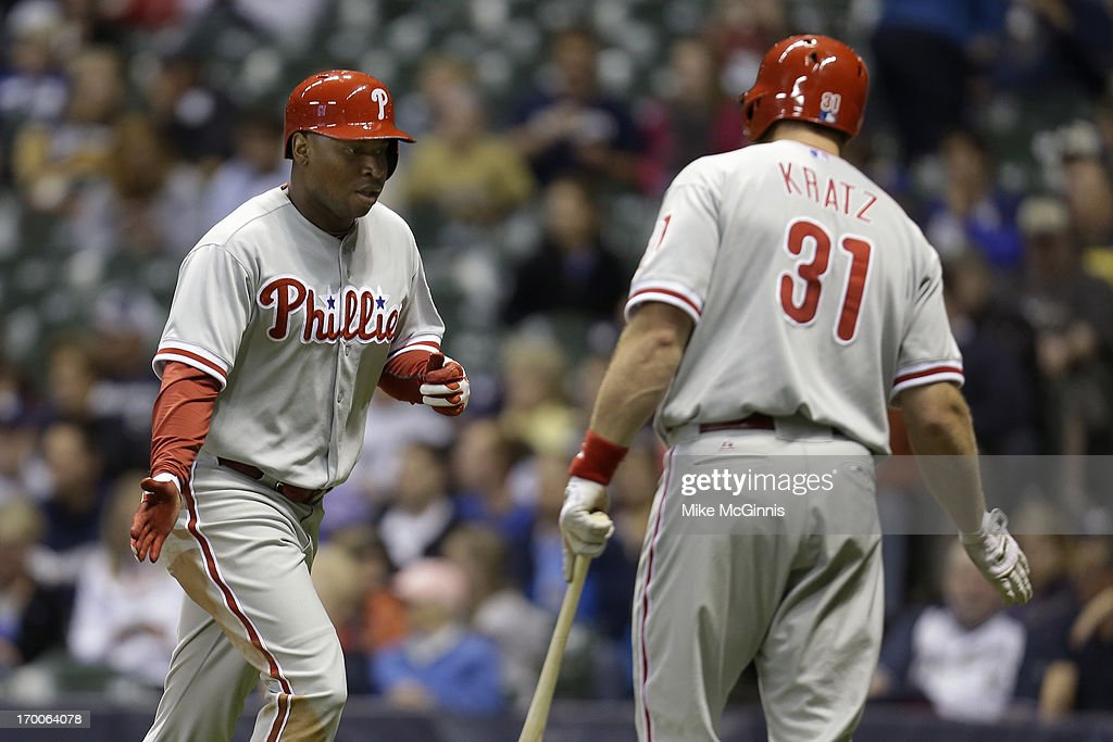 <a gi-track='captionPersonalityLinkClicked' href=/galleries/search?phrase=Delmon+Young&family=editorial&specificpeople=700362 ng-click='$event.stopPropagation()'>Delmon Young</a> #3 of the Philadelphia is congratulated by <a gi-track='captionPersonalityLinkClicked' href=/galleries/search?phrase=Erik+Kratz&family=editorial&specificpeople=809194 ng-click='$event.stopPropagation()'>Erik Kratz</a> #31after hitting a solo home run in the top of the fifth inning against the Milwaukee Brewers at Miller Park on June 06, 2013 in Milwaukee, Wisconsin.