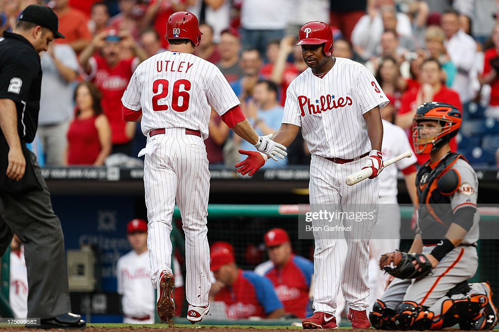 <a gi-track='captionPersonalityLinkClicked' href=/galleries/search?phrase=Delmon+Young&family=editorial&specificpeople=700362 ng-click='$event.stopPropagation()'>Delmon Young</a> #3 of the Philadelphia Phillies congratulates <a gi-track='captionPersonalityLinkClicked' href=/galleries/search?phrase=Chase+Utley&family=editorial&specificpeople=161391 ng-click='$event.stopPropagation()'>Chase Utley</a> #26 after Utley hit a solo home run in the first inning of the game against the San Francisco Giants at Citizens Bank Park on July 31, 2013 in Philadelphia, Pennsylvania.