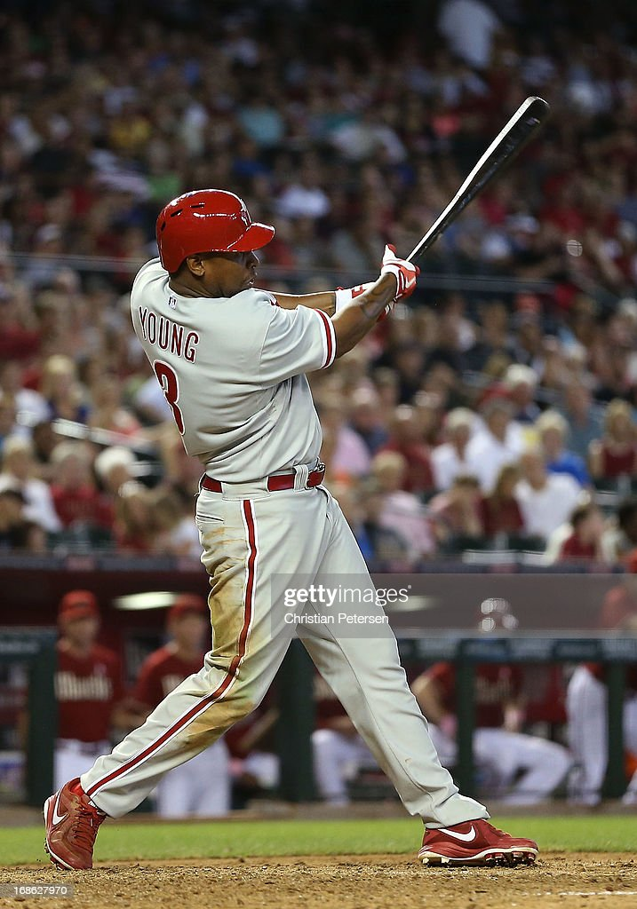 Delmon Young #3 of the Philadelphia Phillies hits a RBI double against the Arizona Diamondbacks during the ninth inning of the MLB game at Chase Field on May 12, 2013 in Phoenix, Arizona.