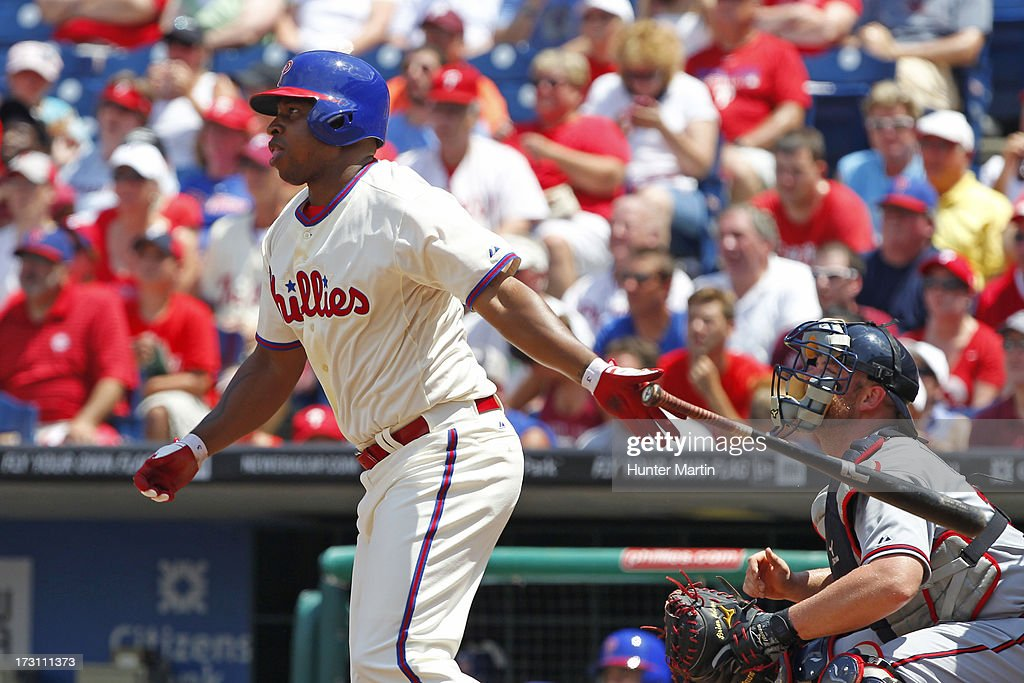 <a gi-track='captionPersonalityLinkClicked' href=/galleries/search?phrase=Delmon+Young&family=editorial&specificpeople=700362 ng-click='$event.stopPropagation()'>Delmon Young</a> #3 of the Philadelphia Phillies hits an RBI single in the first inning during a game against the Atlanta Braves at Citizens Bank Park on July 7, 2013 in Philadelphia, Pennsylvania.
