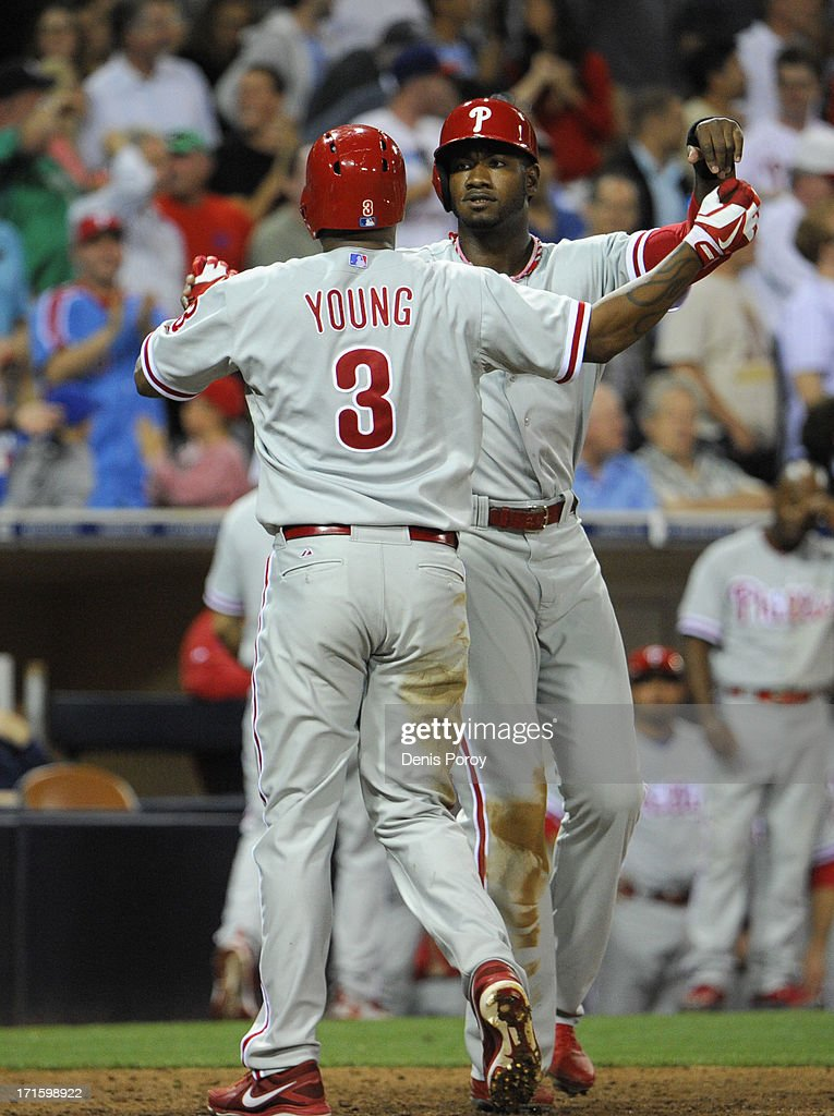 Delmon Young #3 of the Philadelphia Phillies is congratulated by Domonic Brown #9 after he hit a two-run home run during the eighth inning of a baseball game against the San Diego Padres at Petco Park on June 26, 2013 in San Diego, California.