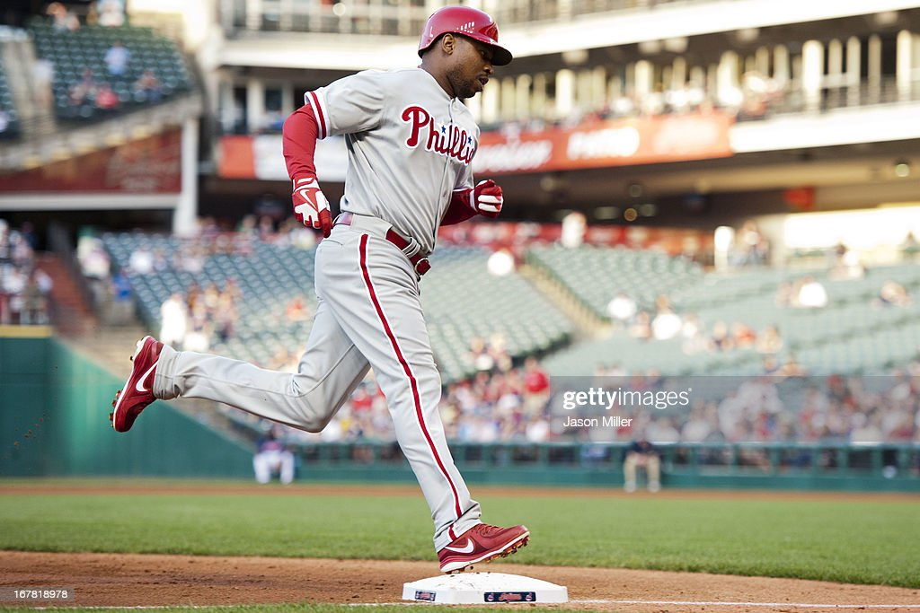 <a gi-track='captionPersonalityLinkClicked' href=/galleries/search?phrase=Delmon+Young&family=editorial&specificpeople=700362 ng-click='$event.stopPropagation()'>Delmon Young</a> #3 of the Philadelphia Phillies rounds the bases after hitting a solo home run during the second inning against the Cleveland Indians at Progressive Field on April 30, 2013 in Cleveland, Ohio.