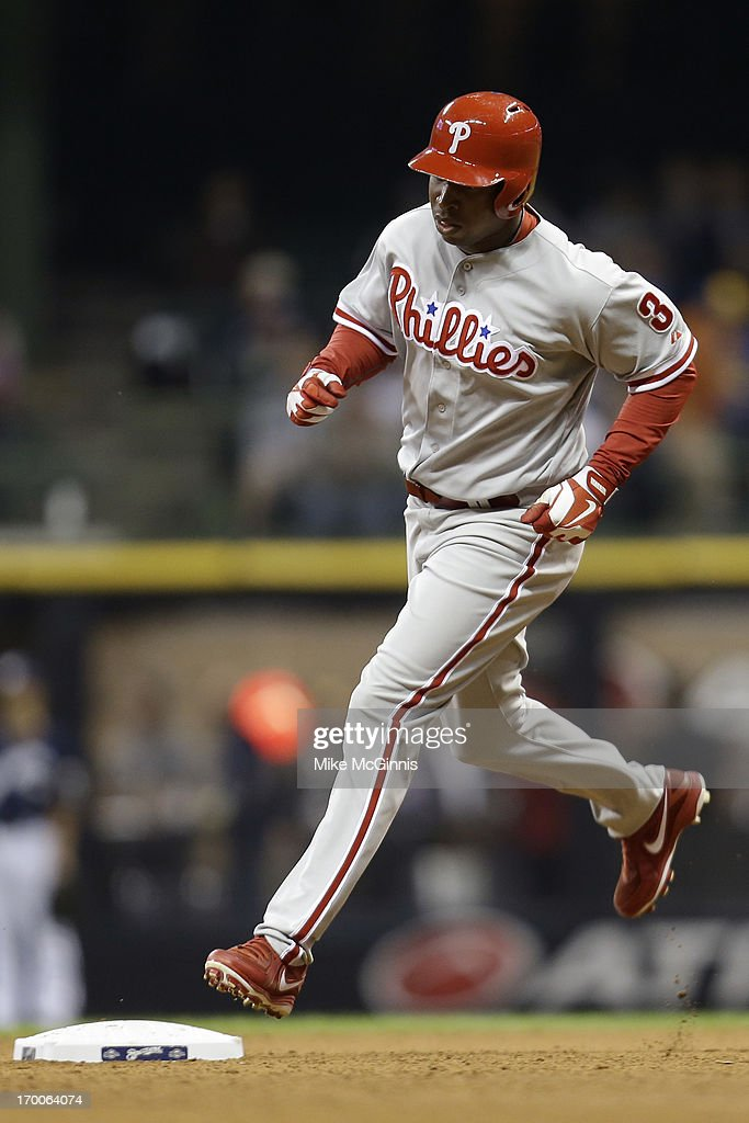 <a gi-track='captionPersonalityLinkClicked' href=/galleries/search?phrase=Delmon+Young&family=editorial&specificpeople=700362 ng-click='$event.stopPropagation()'>Delmon Young</a> #3 of the Philadelphia runs the bases after hitting a solo home run in the top of the fifth inning against the Milwaukee Brewers at Miller Park on June 06, 2013 in Milwaukee, Wisconsin.