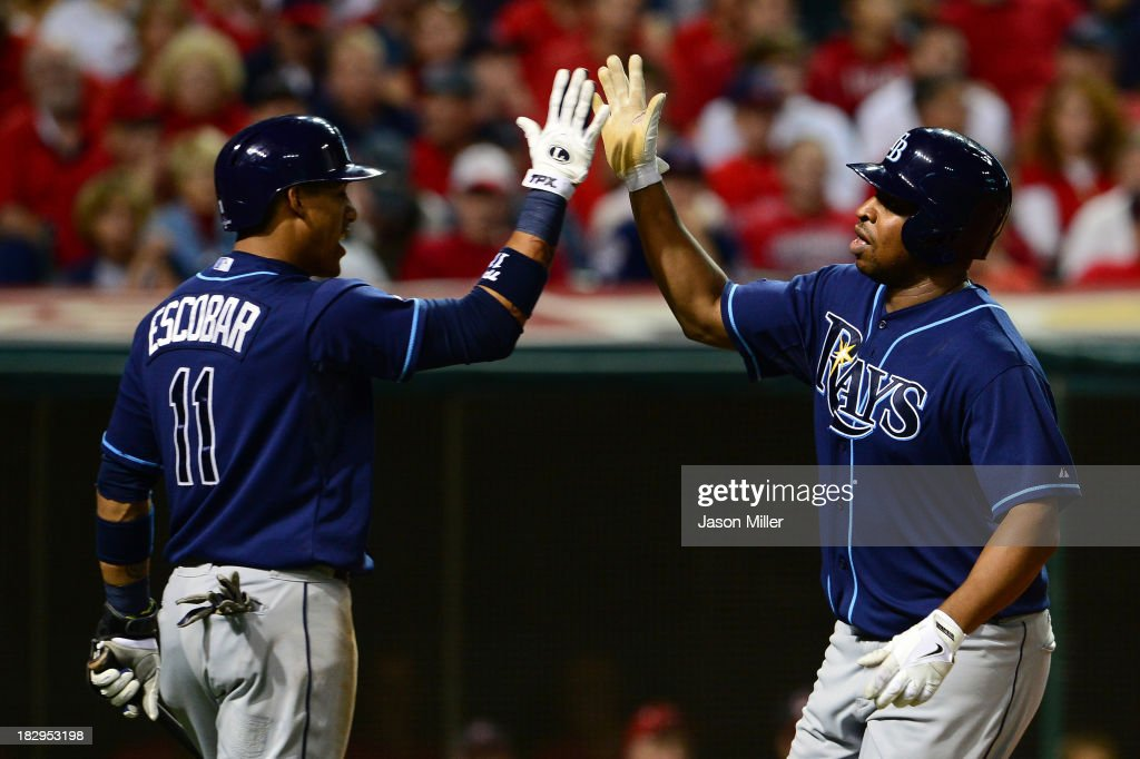 <a gi-track='captionPersonalityLinkClicked' href=/galleries/search?phrase=Delmon+Young&family=editorial&specificpeople=700362 ng-click='$event.stopPropagation()'>Delmon Young</a> #15 of the Tampa Bay Rays celebrates with his teammate <a gi-track='captionPersonalityLinkClicked' href=/galleries/search?phrase=Yunel+Escobar&family=editorial&specificpeople=757358 ng-click='$event.stopPropagation()'>Yunel Escobar</a> #11 of the Tampa Bay Rays after hitting a solo home run in the third inning against Danny Salazar #31 of the Cleveland Indians during the American League Wild Card game at Progressive Field on October 2, 2013 in Cleveland, Ohio.