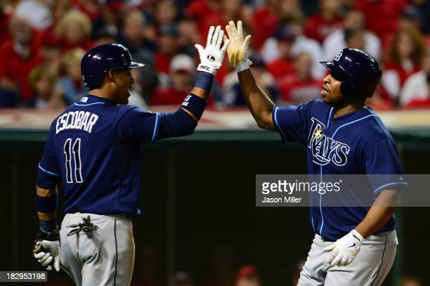 Delmon Young of the Tampa Bay Rays celebrates with his teammate Yunel Escobar of the Tampa Bay Rays after hitting a solo home run in the third inning...