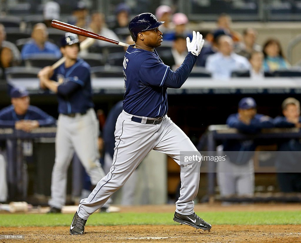 Delmon Young #15 of the Tampa Bay Rays drives in a run in the ninth inning against the New York Yankees on September 24, 2013 at Yankee Stadium in the Bronx borough of New York City.