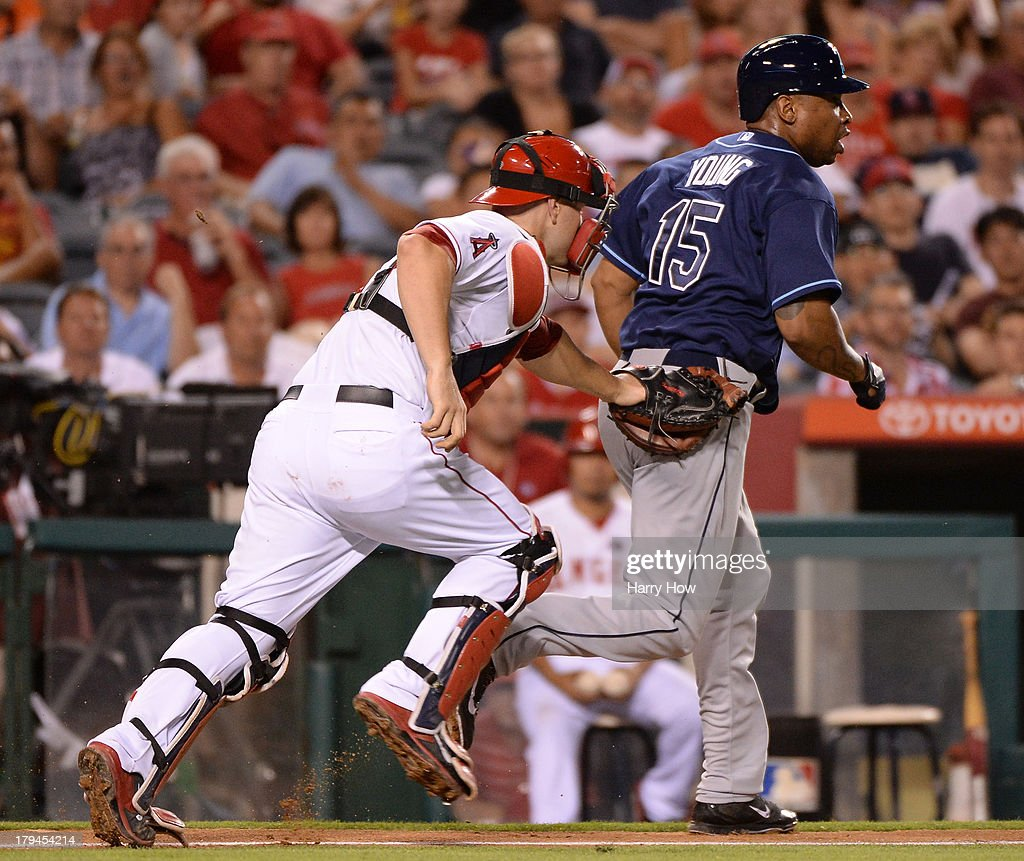 <a gi-track='captionPersonalityLinkClicked' href=/galleries/search?phrase=Delmon+Young&family=editorial&specificpeople=700362 ng-click='$event.stopPropagation()'>Delmon Young</a> #15 of the Tampa Bay Rays is caught by <a gi-track='captionPersonalityLinkClicked' href=/galleries/search?phrase=Chris+Iannetta&family=editorial&specificpeople=836137 ng-click='$event.stopPropagation()'>Chris Iannetta</a> #17 of the Los Angeles Angels for an out between third base and home during the fifth inning at Angel Stadium of Anaheim on September 3, 2013 in Anaheim, California.