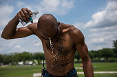 Delmont 'Rabbit' Ward cools off with some water near the Washington Monument in Washington DC on July 12 2016 Ward was helping erect audio and video...