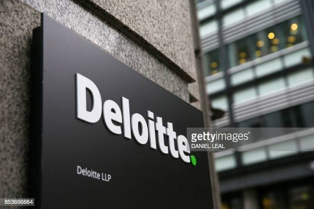 A Deloitte logo is pictured on a sign outside the company's offices in London on September 25 2017 Deloitte said Monday that 'very few' of the...