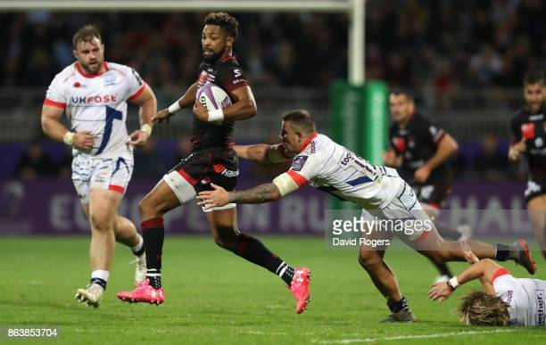 Delon Armitage of Lyon is tackled by Mark Jennings during the European Rugby Challenge Cup match between Lyon and Sale Sharks at Matmut Stade de...