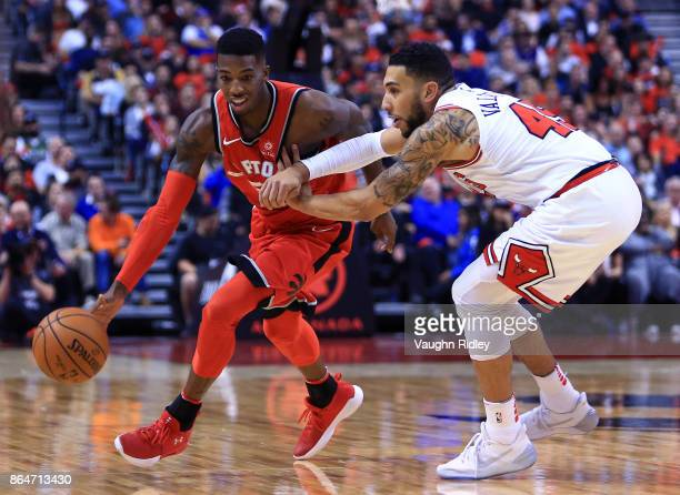 Delon Wright of the Toronto Raptors dribbles the ball as Denzel Valentine of the Chicago Bulls defends during the second half of an NBA game at Air...