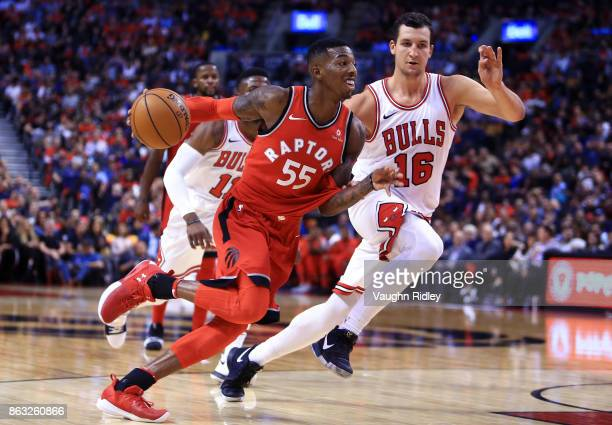 Delon Wright of the Toronto Raptors dribbles the ball as Paul Zipser of the Chicago Bulls defends during the second half of an NBA game at Air Canada...