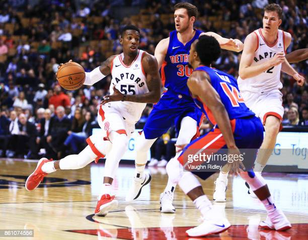 Delon Wright of the Toronto Raptors dribbles the ball during the second half of an NBA preseason game against the Detroit Pistons at Air Canada...
