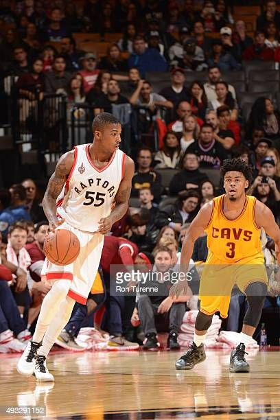 Delon Wright of the Toronto Raptors drives to the basket against Quinn Cook of the Cleveland Cavaliers during the game on October 18 2015 at the Air...