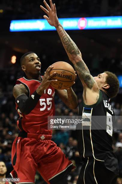 Delon Wright of the Toronto Raptors drives to the basket against Michael Beasley of the Milwaukee Bucks during the second half of Game Three of the...