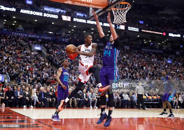 Delon Wright of the Toronto Raptors drives to the basket against the Charlotte Hornets on March 29 2017 at the Air Canada Centre in Toronto Ontario...