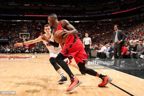 Delon Wright of the Toronto Raptors drives to the basket during the game against the Miami Heat on March 23 2017 at AmericanAirlines Arena in Miami...