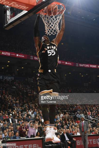 Delon Wright of the Toronto Raptors dunks the ball during a game against the Philadelphia 76ers on April 2 2017 at the Air Canada Centre in Toronto...