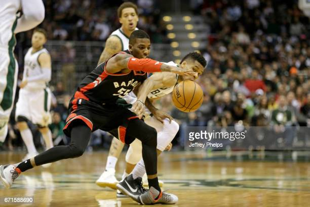 Delon Wright of the Toronto Raptors goes for the loose ball during the game against the Milwaukee Bucks during Game Four of the Eastern Conference...
