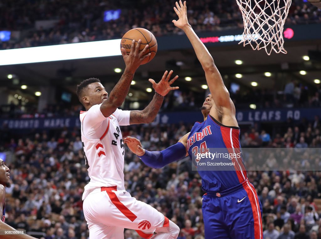 Delon Wright #55 of the Toronto Raptors goes to the basket against Tobias Harris #34 of the Detroit Pistons at Air Canada Centre on January 17, 2018 in Toronto, Canada.