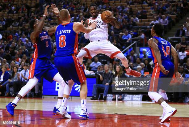 Delon Wright of the Toronto Raptors juggles the ball as Andre Drummond Henry Ellenson and Ish Smith of the Detroit Pistons defend during the second...