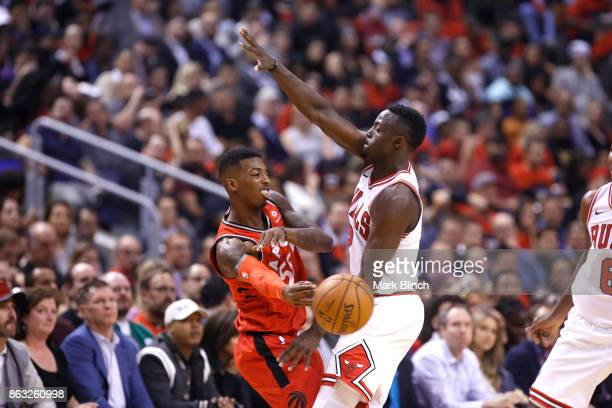 Delon Wright of the Toronto Raptors passes the ball against the Chicago Bulls during the game on October 19 2017 at the Air Canada Centre in Toronto...
