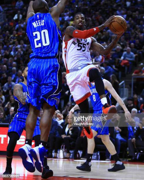 Delon Wright of the Toronto Raptors passes the ball as Jodie Meeks of the Orlando Magic defends during the second half of an NBA game at Air Canada...