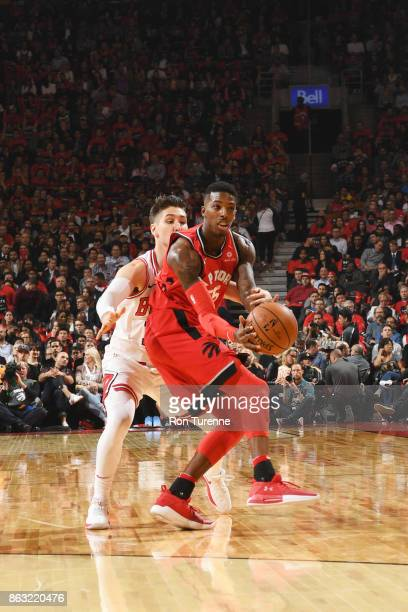 Delon Wright of the Toronto Raptors passes the ball during the game against the Chicago Bulls on October 19 2017 at the Air Canada Centre in Toronto...