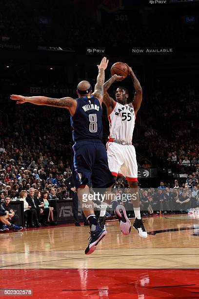 Delon Wright of the Toronto Raptors shoots against Deron Williams of the Dallas Mavericks on December 22 2015 at the Air Canada Centre in Toronto...