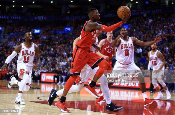 Delon Wright of the Toronto Raptors shoots the ball as Paul Zipser of the Chicago Bulls defends during the second half of an NBA game at Air Canada...