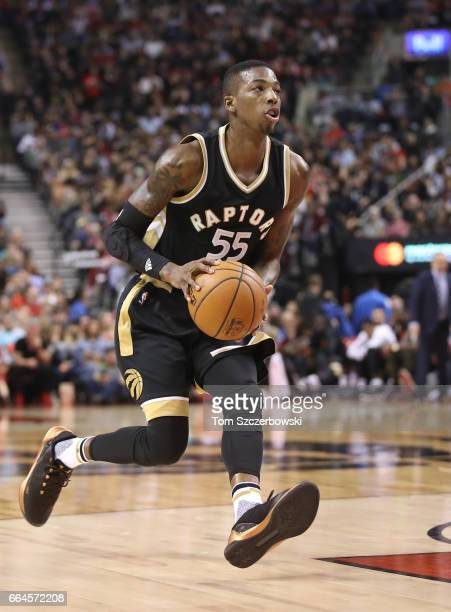 Delon Wright of the Toronto Raptors with the ball against the Philadelphia 76ers during NBA game action at Air Canada Centre on April 2 2017 in...