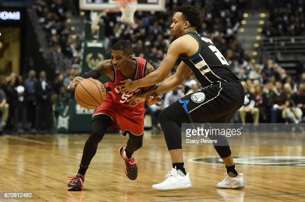 Delon Wright of the Toronto Raptors works against Rashad Vaughn of the Milwaukee Bucks during the second half of Game Three of the Eastern Conference...
