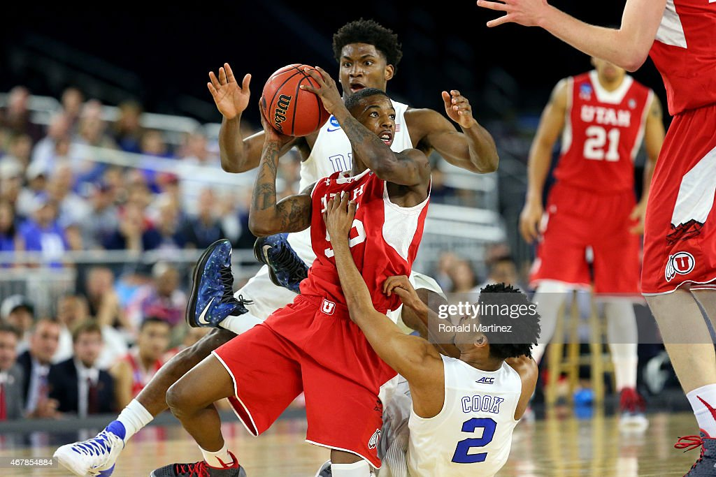Delon Wright #55 of the Utah Utes and Quinn Cook #2 and Justise Winslow #12 of the Duke Blue Devils battle for a loose ball during a South Regional Semifinal game of the 2015 NCAA Men's Basketball Tournament at NRG Stadium on March 27, 2015 in Houston, Texas.