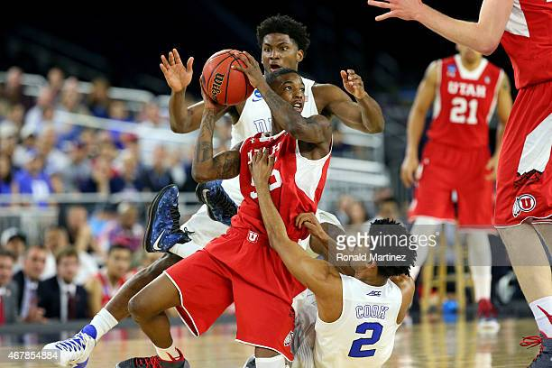 Delon Wright of the Utah Utes and Quinn Cook and Justise Winslow of the Duke Blue Devils battle for a loose ball during a South Regional Semifinal...