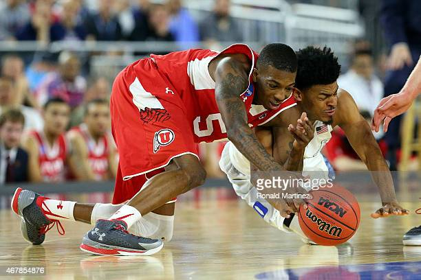 Delon Wright of the Utah Utes and Quinn Cook of the Duke Blue Devils dive for a loose ball during a South Regional Semifinal game of the 2015 NCAA...