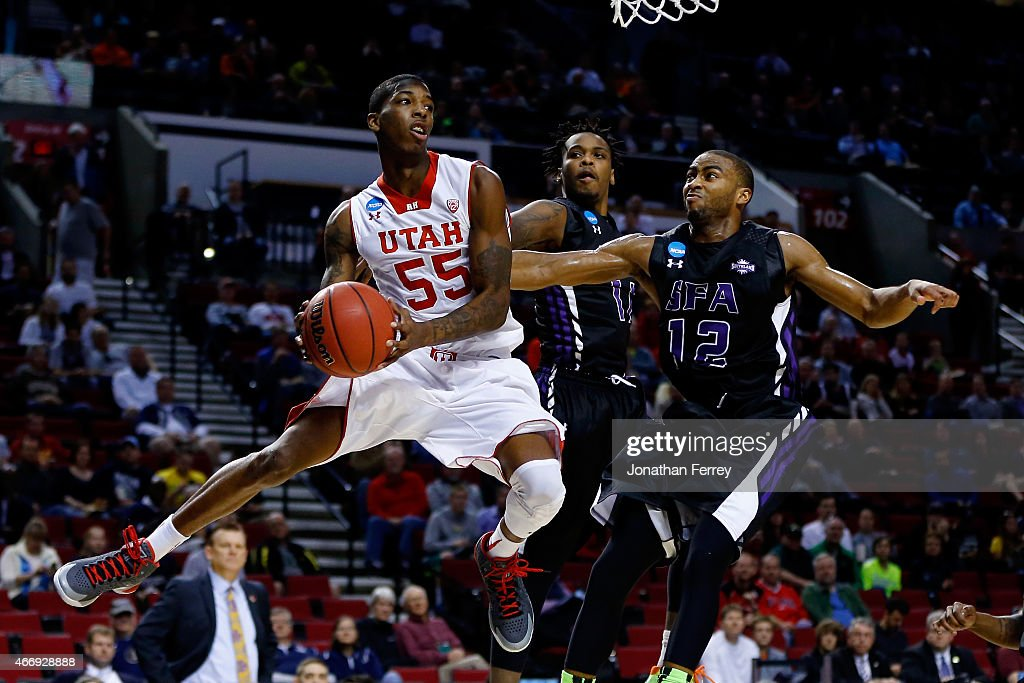 Delon Wright #55 of the Utah Utes controls the ball under the basket against Dallas Cameron #12 of the Stephen F. Austin Lumberjacks in the first half during the second round of the 2015 NCAA Men's Basketball Tournament at Moda Center on March 19, 2015 in Portland, Oregon.