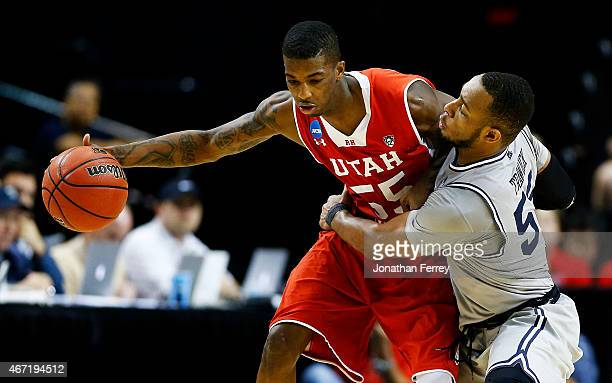 Delon Wright of the Utah Utes drives against Jabril Trawick of the Georgetown Hoyas in the second half during the third round of the 2015 NCAA Men's...