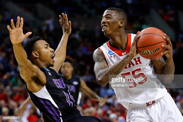 Delon Wright of the Utah Utes drives to the basket as Clide Geffrard of the Stephen F Austin Lumberjacks falls in the first half during the second...