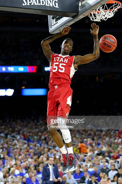Delon Wright of the Utah Utes dunks against the Duke Blue Devils during a South Regional Semifinal game of the 2015 NCAA Men's Basketball Tournament...