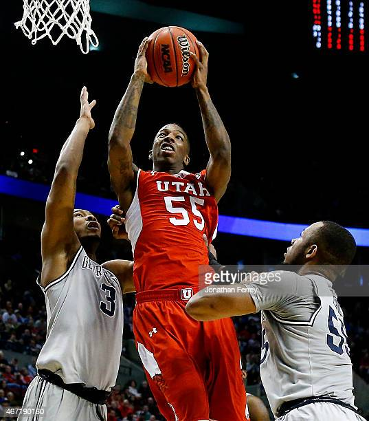 Delon Wright of the Utah Utes goes up against Mikael Hopkins and Jabril Trawick of the Georgetown Hoyas in the first half during the third round of...