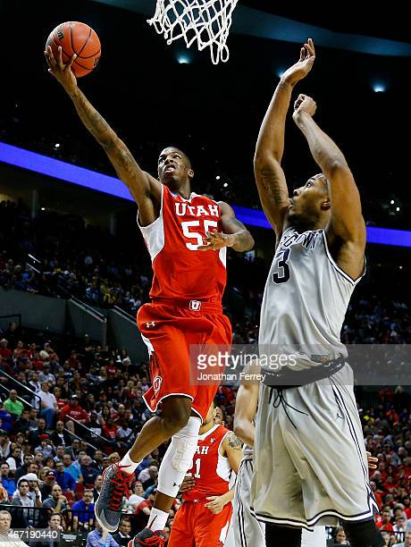 Delon Wright of the Utah Utes goes up against Mikael Hopkins of the Georgetown Hoyas in the first half during the third round of the 2015 NCAA Men's...